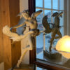 A sculpture of Michael Parkes Night Flight in a room