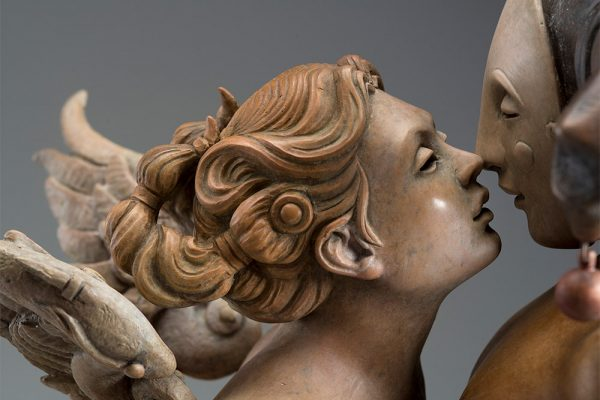 A sculpture of Michael Parkes called Kissing (Close-up)